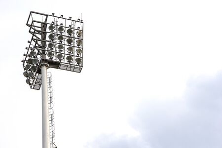 sports field: Spotlight on lighting tower of stadium background Stock Photo