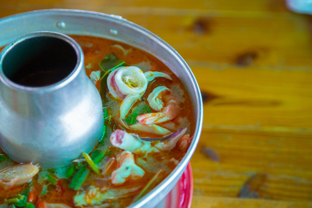 goong: Tom Yum Goong,spicy prawn soup Thai Food on wood background