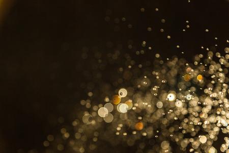 黄金ビンテージぼかしボケ味の黒い背景にデフォーカス 写真素材