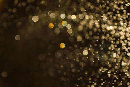 colorful lights: Golden Vintage blur bokeh defocused on black background