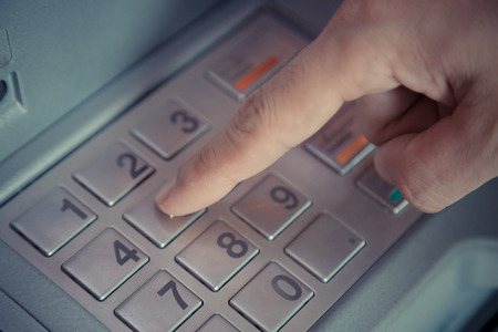 bank withdrawal: Press ATM EPP password keyboard background