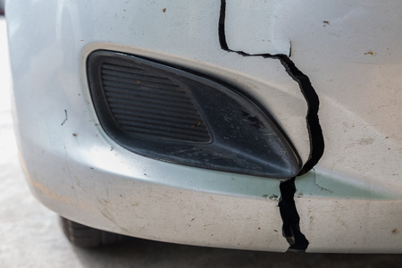 front bumper: car has a dentedand damage at  front bumper from accident Stock Photo