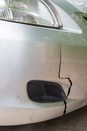 fender bender: car has a dentedand damage at  front bumper from accident Stock Photo