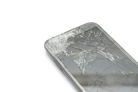 Close up of broken screen smart phone isolated on white background