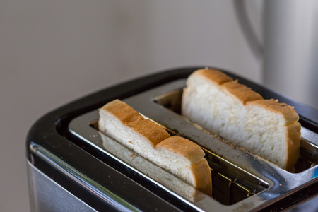 ready to eat: Toaster and two hot toasts ready to eat for the breakfas
