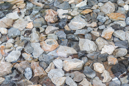 riverbed: Photo of surface water with rocks underwater background