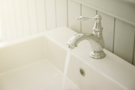 faucets: faucets at toilet background