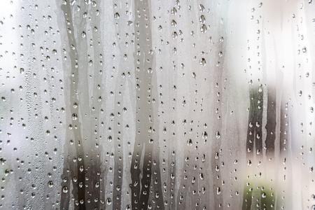 kropla deszczu: Water drop on the glass of windows background Zdjęcie Seryjne