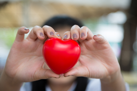 heartshaped: Woman hold red heart use for background