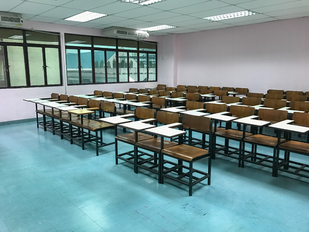 Wooden chairs in the classroom background