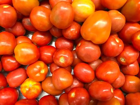 Fresh Tomatoes on the market background Stock Photo
