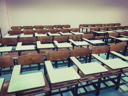 office furniture: Wooden chairs in the classroom background