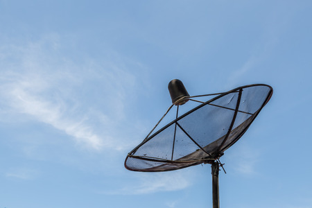 satelite: Old satellite dish on blue sky baclground