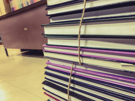 bibliography: Pile of old books with rope background