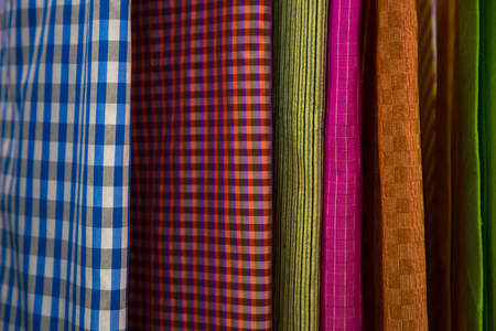 Raw of colorful Thai silk handcraft old vintage torn from natural materials  texture backgroun Stock Photo