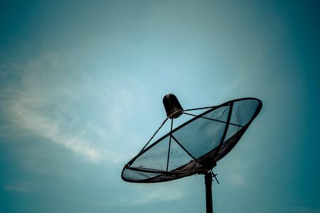 receiver: Old satellite dish on blue sky baclground