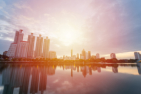 Blur City building with water reflection before sunset background Stock Photo