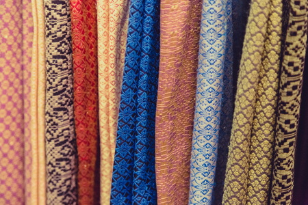 oriental rug: Raw of colorful Thai silk handcraft old vintage torn from natural materials  texture backgroun Stock Photo