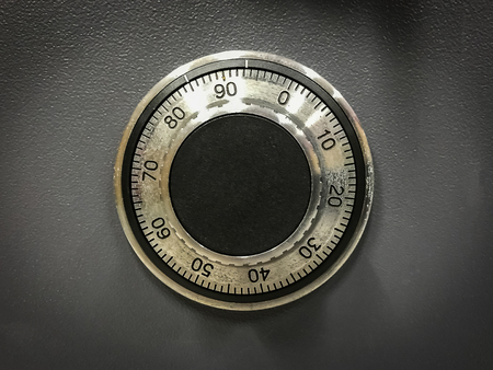 Close up of mechanism old safe security code background 스톡 콘텐츠