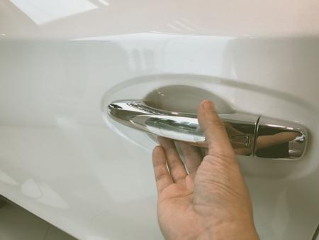 automobile door: The mans hand is opening the car door background
