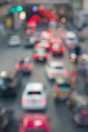 Blur of traffic jam in the city with traffic light background