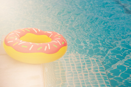 Rubber ring in blue swimming pool background Archivio Fotografico