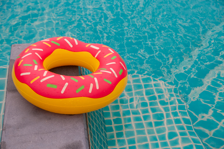 Rubber ring in blue swimming pool background Stock Photo