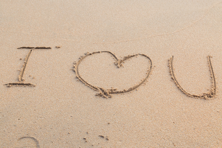 Message i love you on the sand beach background 版權商用圖片