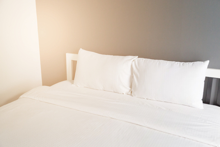 Two white pillow on bed and blanket in the bedroom