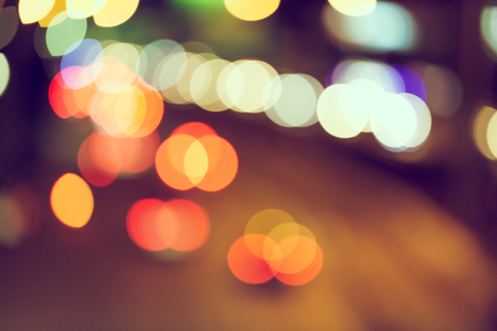 Abstract defocus of bokeh light traffic in the city background