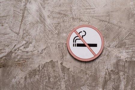 No smoking sign on the gray cement wall background