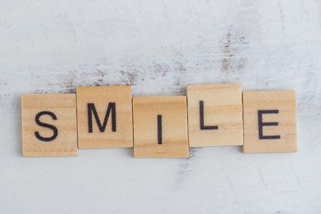 Alphabet smile word on white old vintage wood background Stockfoto