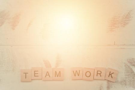 Alphabet Team work on old white vintage wood background 写真素材