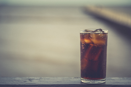Cola with ice in the glass ready to drink for refresh on blur background