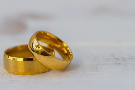 Golden rings, wedding rings of the bride and groom on white vintage wooden background 写真素材 - 122657469