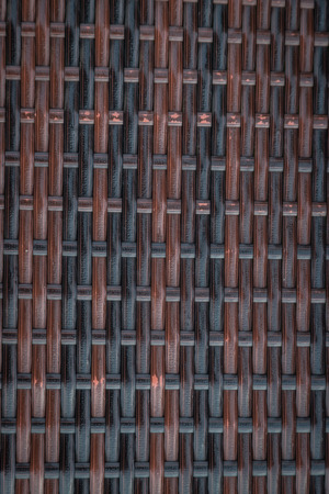 Detail of woven rattan in dark wood pattern