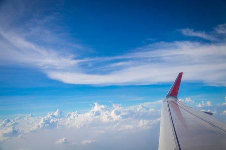 Sky and clouds from above the ground viewed from an airplane nature background Stock Photo