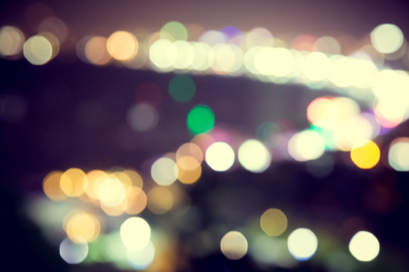 Blur defocus bokeh of light in the city with dark background