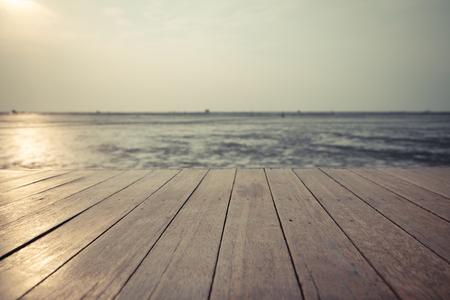Vintage wood floor extends into the sea when the water drops
