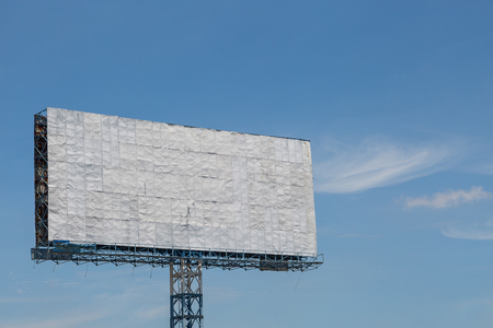 White billboard with blue sky and clouds background Stock Photo