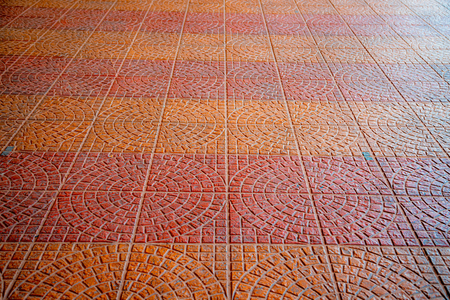 Cobblestone pavement with circular pattern background Stock Photo