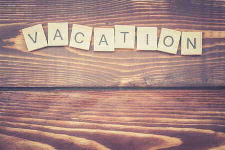 Alphabet Vacation on old vintage wood background