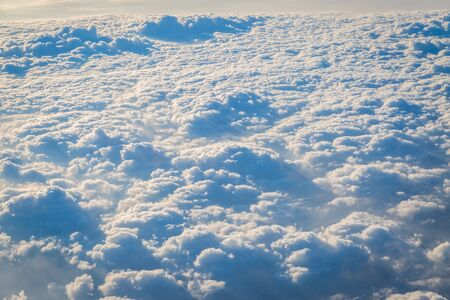 Sky and clouds from above the ground viewed from an airplane nature background