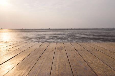 The wood floor extends into the sea when the water drops
