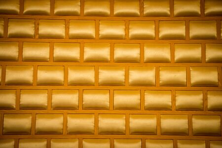 Elegant saturated glossy gold leather texture of wall background