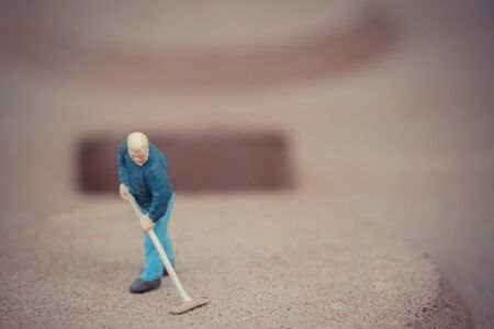 Miniature people cleaning the floor background