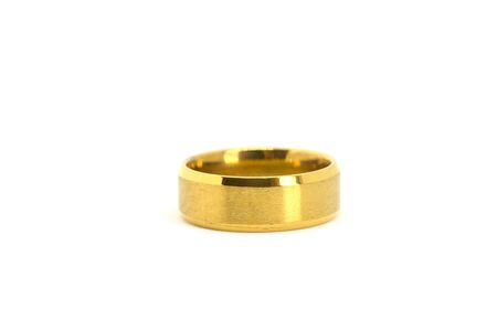 Close up of gold rings for wedding of bride and groom isolated on white background Stock Photo