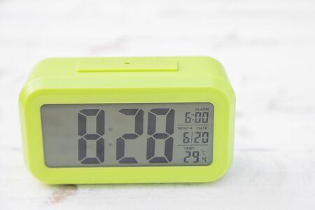 Light green digital clock on vintage wooden panels Stock Photo - 125210348