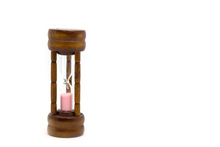 Wood grain hourglass on a white background