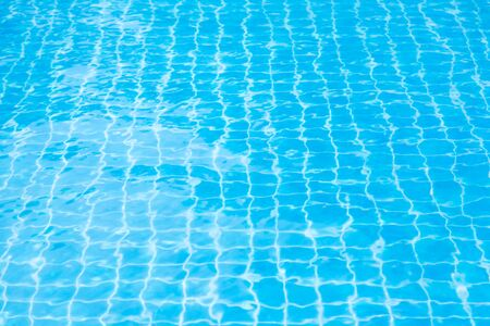Reflections from the water in the blue swimming pool background